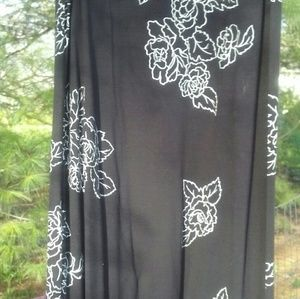 Dresses & Skirts - Long black skirt with white roses in size large.
